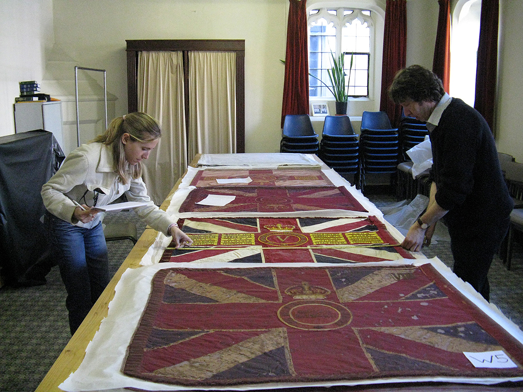 Surveying the condition of the collection of Regimental Colours.