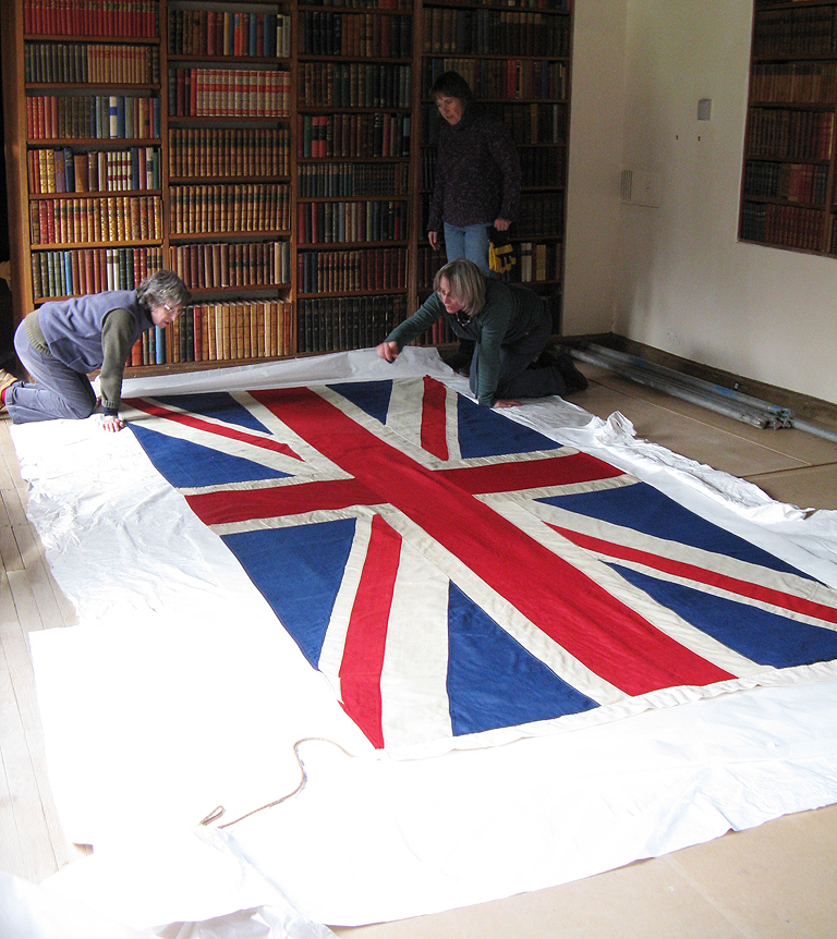 Preparing the flag for reinstatement, on site.