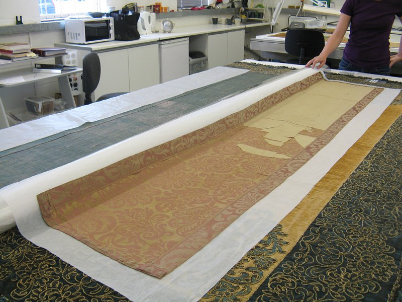The unfaded reverse side of the replacement damask panels.