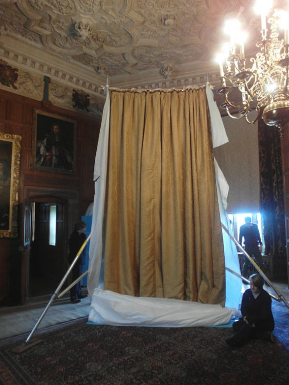 The curtain tied to scaffold during installation.