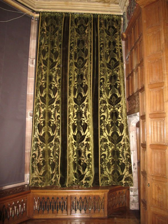 The curtain in place after conservation treatment.