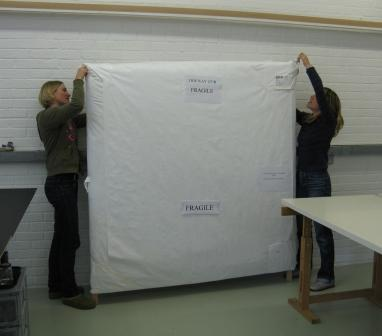 The banner arriving at the studio fully packed.