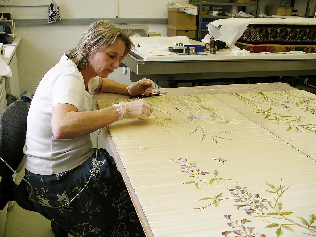 Reducing the water stains on a the silk embroidered panel of a Screen.