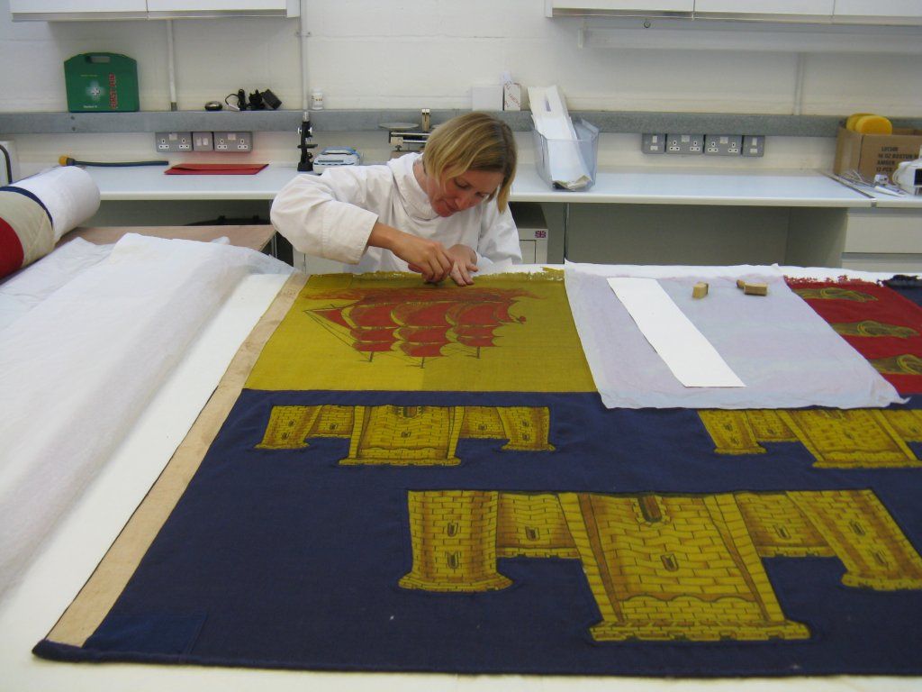 Gerda surface cleaning Churchill's Cinque Portes Standard with a sponge.