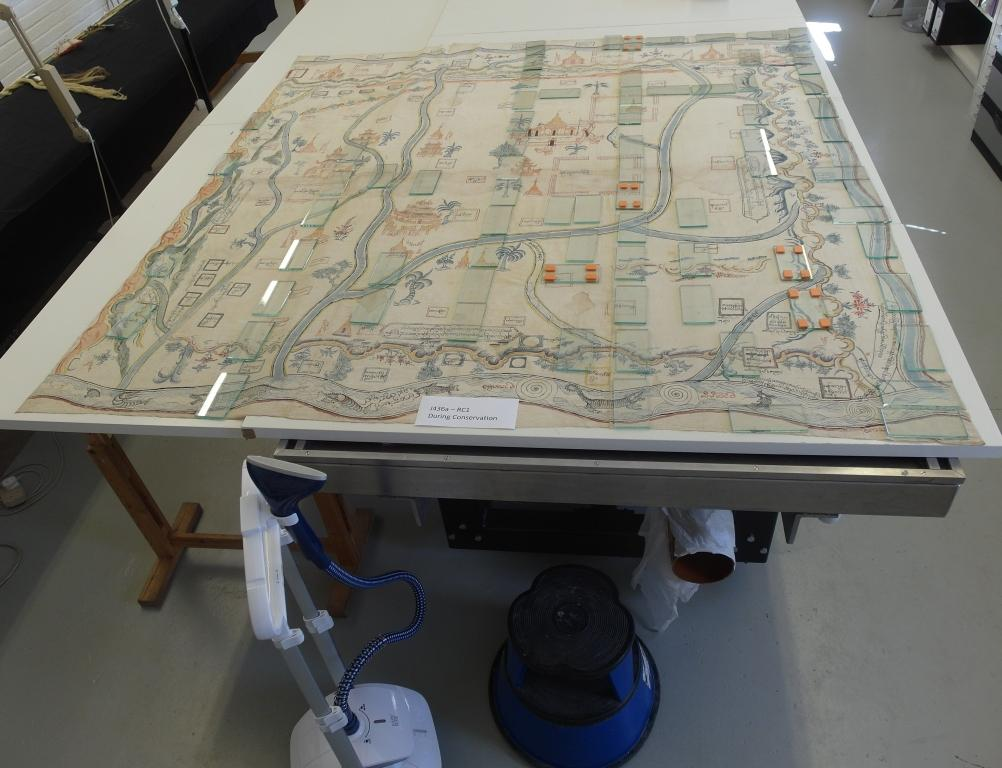 Hand-painted Burmese Map (Maps.Ms.plans.Rc.1) during Conservation. Humidifying process to ease the creases