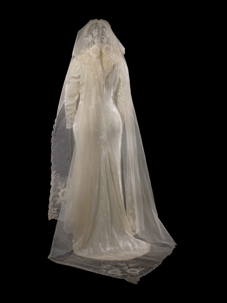Back view showing the veil of Mrs. Albertson's wedding dress