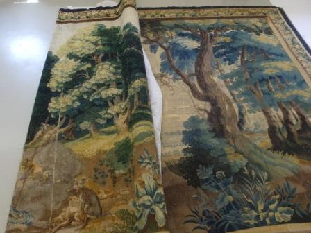 The colour change on the front of the tapestry (right) compared to the reverse (left) Note the dramatic change in the green foliage to blue. This is due to the faster fading of the yellow dye than the blue dye which are combined to produce the final green intended in the original.