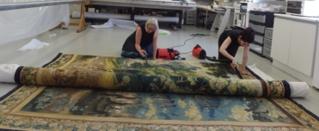 May and Maria vacuuming the reverse of the tapestry
