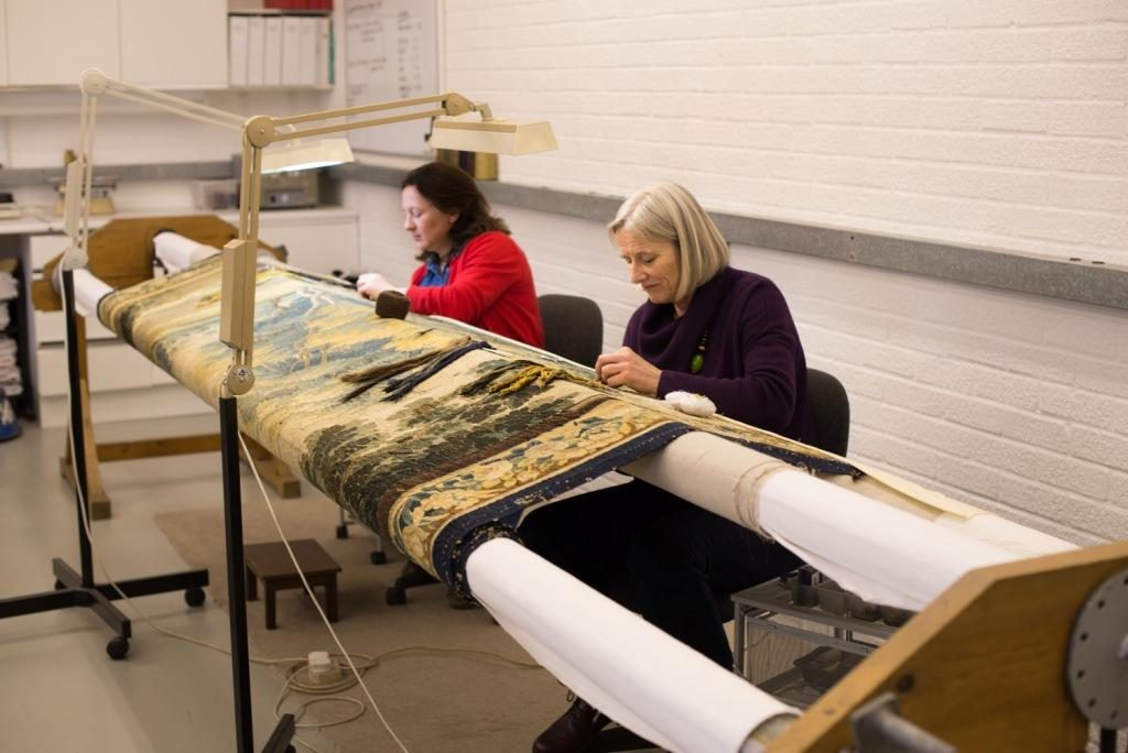 May and Anna stitching the tapestry on the frame