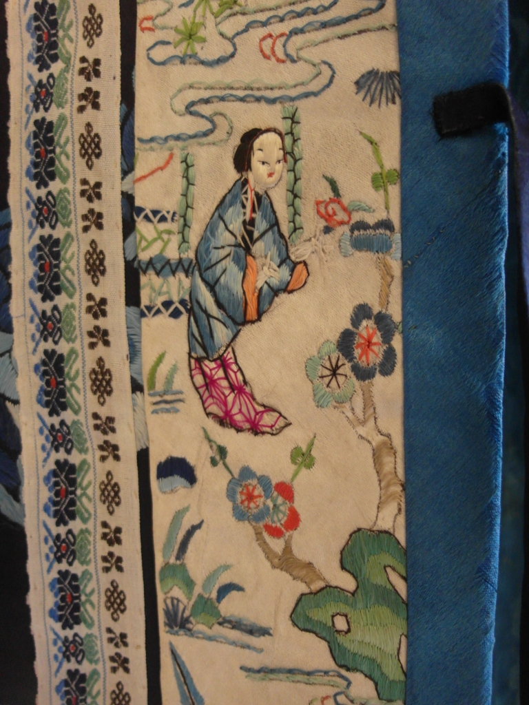 6. Detail of blue embroidered silk robe, AC web